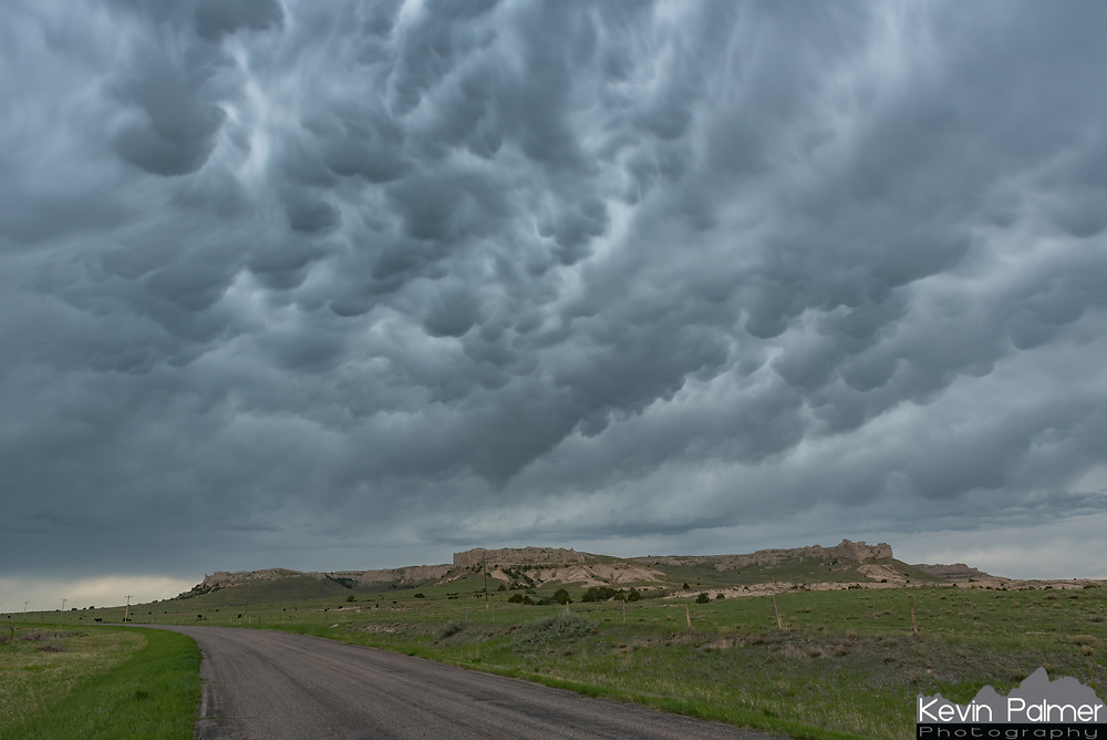 Mammatus clouds fill the sky over a bluff west of La Grange, Wyoming.