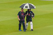 Jonny Bairstow of England walks across the outfield under and umbrella on his way to practice his batting ahead of the International Test Match 2019 match between England and Australia at Lord's Cricket Ground, St John's Wood, United Kingdom on 14 August 2019.