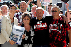 "© Licensed to London News Pictures. 31/08/2013. London, UK. Lorraine Etherington (L), Lorraine Salvage (2L) and Mark Peterson (2R), sister, cousin and brother of of prisoner Charles Bronson, are seen with other friends and relatives before handing in a petition for his release to Number 10 Downing Street in London today (31/08/2013). Often referred to in the British press as the ""most violent prisoner in Britain"", Bronson is currently being held on a life sentence in Wakefield High-Security Prison. Photo credit: Matt Cetti-Roberts/LNP"