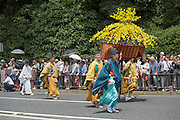 Procession during the Aoi Matsuri. The festival is held on 15 May each year and is one of the 3 major festivals of Kyoto. The route begins at the Imperial Palace before heading through the city streets eventually ending up at Shimogamo shrine and finally the Kamigamo shrine. During both shrine visits, various rites are held.