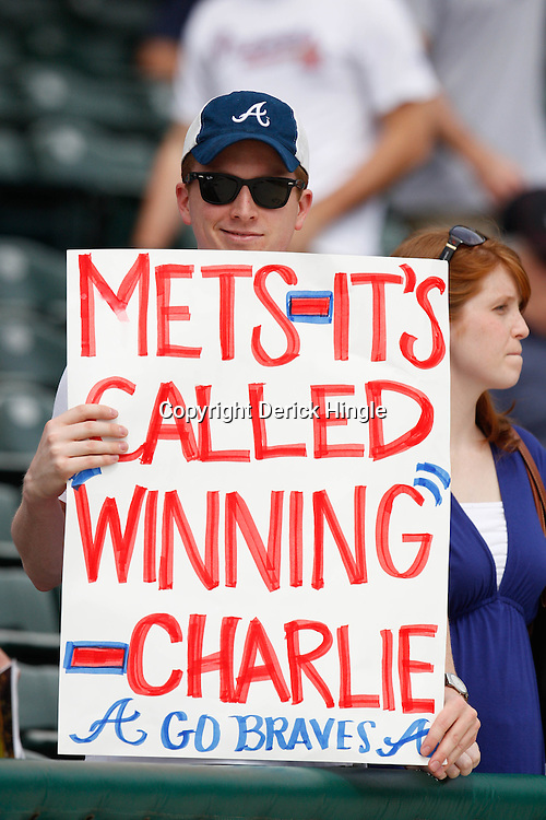 March 5, 2011; Lake Buena Vista, FL, USA; A Atlanta Braves fan holds up a sign before a spring training exhibition game against the New York Mets at Disney Wide World of Sports complex.  Mandatory Credit: Derick E. Hingle
