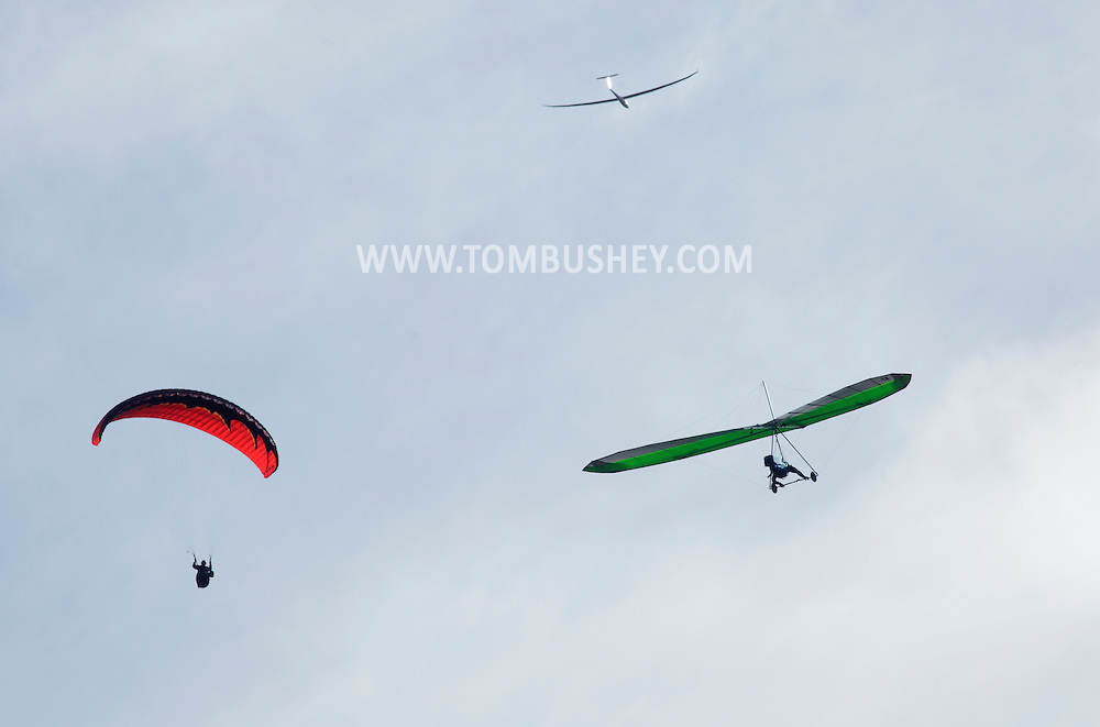 Ellenville, NY - A hang glider, a paraglider and a glider soar in the sky on Oct. 25, 2009.