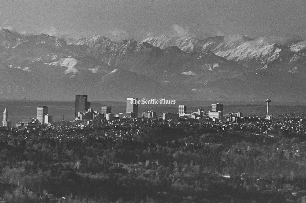 About 10 miles separated the camera and Seattle's taller structures in this telephoto-lens view from the Eastside's Somerset community. The Olympic peaks are 50 miles farther away. The north part of Mercer Island is in the foreground. (Larry Dion / The Seattle Times)