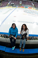 KELOWNA, CANADA - APRIL 7: Kelowna Rockets' photographers Cindy Rogers and Marissa Baecker sit on the bench for a photo on April 7, 2017 at Prospera Place in Kelowna, British Columbia, Canada.  (Photo by Marissa Baecker/Shoot the Breeze)  *** Local Caption ***
