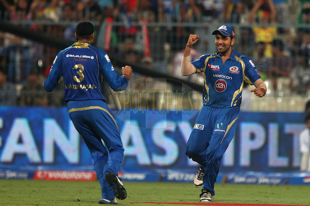 Rohit Sharma celebrates the wicket of Shane Watson during the 2nd Qualifying match of the Pepsi Indian Premier League between The Rajasthan Royals and the Mumbai Indians  held at the Eden Gardens Stadium in Kolkata on the 24th May 2013..Photo by Ron Gaunt-IPL-SPORTZPICS      ..Use of this image is subject to the terms and conditions as outlined by the BCCI. These terms can be found by following this link:..http://www.sportzpics.co.za/image/I0000SoRagM2cIEc