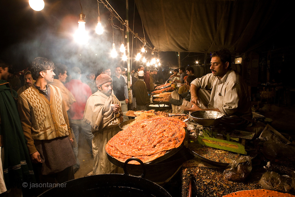 Food trader at the 966th 3-day annual Urs of Ali bin Usman Hajveri commonly known as Data Ganj Bakhsh. The festival commenced in Lahore amidst tight security...During the religious festival thousands of devotees from all over the country converged on the shrine of the Muslim saint Data Ganj Bakhsh to mark the anniversary of his death..