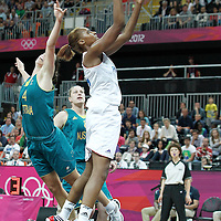 30 July 2012: Sandrine Gruda of France goes for the layup past Jenna O'Hea of Australia during the 74-70 Team France overtime victory over Team Australia, during the women's basketball preliminary, at the Basketball Arena, in London, Great Britain.