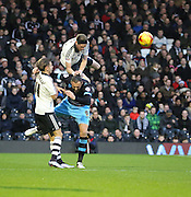 Fulham defender Richard Stearman foulking Sheffield Wednesday striker Atdhe Nuhiu during the Sky Bet Championship match between Fulham and Sheffield Wednesday at Craven Cottage, London, England on 2 January 2016. Photo by Matthew Redman.