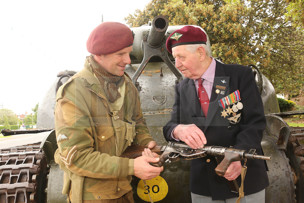 © Licensed to London News Pictures. 03/06/2014. Portsmouth, UK. 91 YEAR OLD PARATROOPER OF 7TH BATALLION PARACHUTE REGIMENT LEONARD BUCKLEY WHO LANDED AT PEGASUS BRIDGE IN NORMANDY  FROM HEREFORD WITH RE ENACTOR MARTIN FIELDEN AT D DAY MUSEUM IN PORTSMOUTH. Photo credit : Jason Bryant/LNP