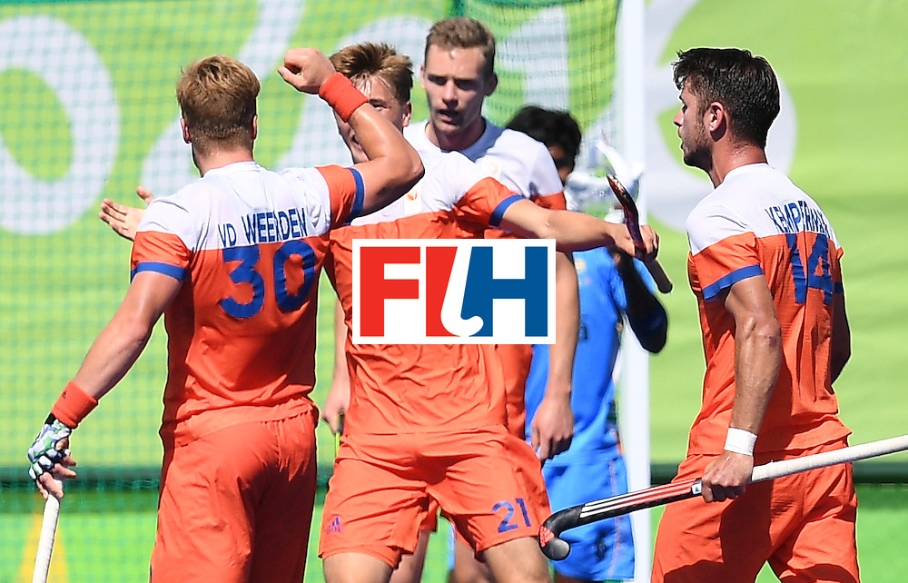 Netherland's Mink van der Weerden (L) celebrates scoring a goal with teammates during the men's field hockey Netherland's vs India match of the Rio 2016 Olympics Games at the Olympic Hockey Centre in Rio de Janeiro on August, 11 2016. / AFP / MANAN VATSYAYANA        (Photo credit should read MANAN VATSYAYANA/AFP/Getty Images)