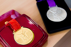 Gold and silver olympic medals during press conference of athlete Primoz Kozmus before new season 2013, on April 23, 2013,in Gen-i energija, Krsko, Slovenia. (Photo By Vid Ponikvar / Sportida.com)