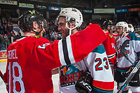 KELOWNA, CANADA - APRIL 14: Matt Revel #18 of the Portland Winterhawks congratulates Reid Gardiner #23 of the Kelowna Rockets on the round 2 series win on April 14, 2017 at Prospera Place in Kelowna, British Columbia, Canada.  (Photo by Marissa Baecker/Shoot the Breeze)  *** Local Caption ***
