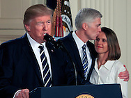 President Donald Trump announces his nomination federal appeals Judge Neil Gorsuch to the U.S. Supreme Court in the East Room of the White House on January 31, 2017 President Donald Trump, Judge Neil Gorsuch and  Judge Neil Gorsuch's wife, Louuse <br /> <br /> Photo by Dennis Brack