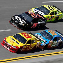April 17, 2011; Talladega, AL, USA; NASCAR Sprint Cup Series driver Kyle Busch (18) drafts Kurt Busch (22) and Paul Menard (27) drafts Regan Smith (78) during the Aarons 499 at Talladega Superspeedway.   Mandatory Credit: Derick E. Hingle