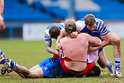 London Broncos interchange Edward Battye (15) is tackled  during the Betfred Championship match between Halifax RLFC and London Broncos at the MBi Shay Stadium, Halifax, United Kingdom on 8 April 2018. Picture by Simon Davies.