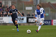 Bristol Rovers Luke James (29) sprints past Southend United Simon Cox (10) with the ball second half  during the EFL Sky Bet League 1 match between Bristol Rovers and Southend United at the Memorial Stadium, Bristol, England on 11 March 2017. Photo by Gary Learmonth.