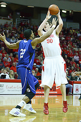 30 January 2011: Blake Mishler works the lane against Kraidon Woods during an NCAA basketball game between the Drake Bulldogs and the Illinois State Redbirds. The Redbirds win in OT 77-75 after a last three point shot by Drake was ruled too late at Redbird Arena in Normal Illinois.