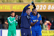 AFC Wimbledon goalkeeping coach Ashley Bayes celebrates with AFC Wimbledon defender Terell Thomas (6) after final whistle  during the EFL Sky Bet League 1 match between AFC Wimbledon and Portsmouth at the Cherry Red Records Stadium, Kingston, England on 19 October 2019.