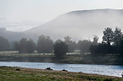 © Licensed to London News Pictures. 13/08/2019. Builth Wells, Powys, UK. Early morning fog is seen in the Wye Valley at Builth Wells in Powys Wales after temperatures dropped to around 6 deg C during the night. Photo credit: Graham M. Lawrence/LNP