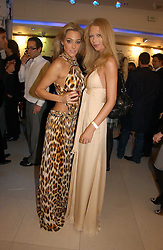 Left to right, JACQUI AINSLEY and ERICA WHITE at the launch of Roberto Cavalli Vodka held in the International Designer Room, Harrods, Hans Crescent, London on 5th December 2006.<br />