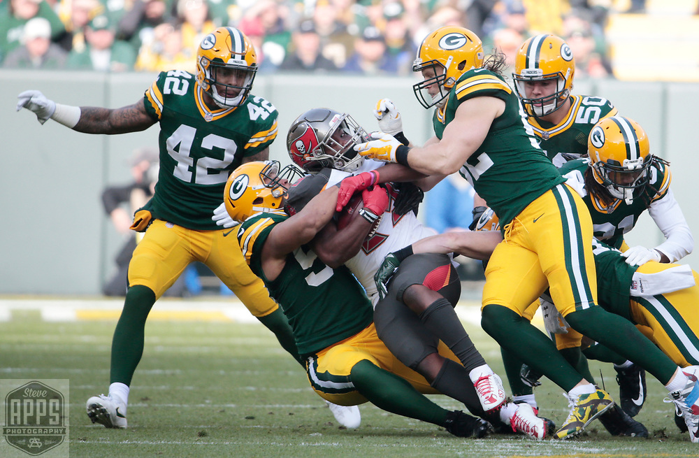 Tampa Bay Buccaneers running back Peyton Barber (25) is stuffed after a 1-yard gain in the 1st quarter. <br /> The Green Bay Packers hosted the Tampa Bay Buccaneers at Lambeau Field in Green Bay,  Sunday, Dec. 3, 2017.  STEVE APPS FOR THE STATE JOURNAL.