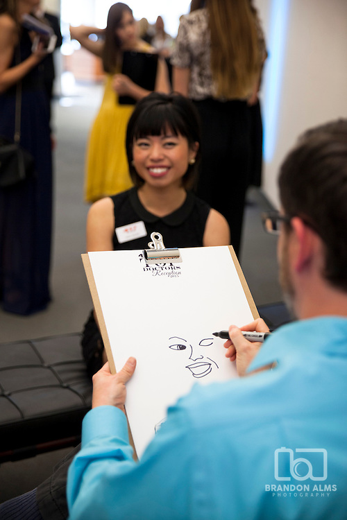 A caricature artist drawing in action.
