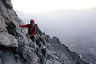 """Alpinists at dawn on the Hornli ridge.<br /> <br /> """"Matterhorn 150 years Cervino"""" - The year 2015 is the 150th Anniversary of the first ascent by Edward Whymper from the Swiss side (14th July) and by Jean Antoine Carrel from the Italian side on the 17th July 1865.<br /> <br /> On 17th July 2015 a friendship convention was signed by the members of Swiss, French, British and Italian climbing teams. A ceremony was held at the summit in honour of the mountain."""