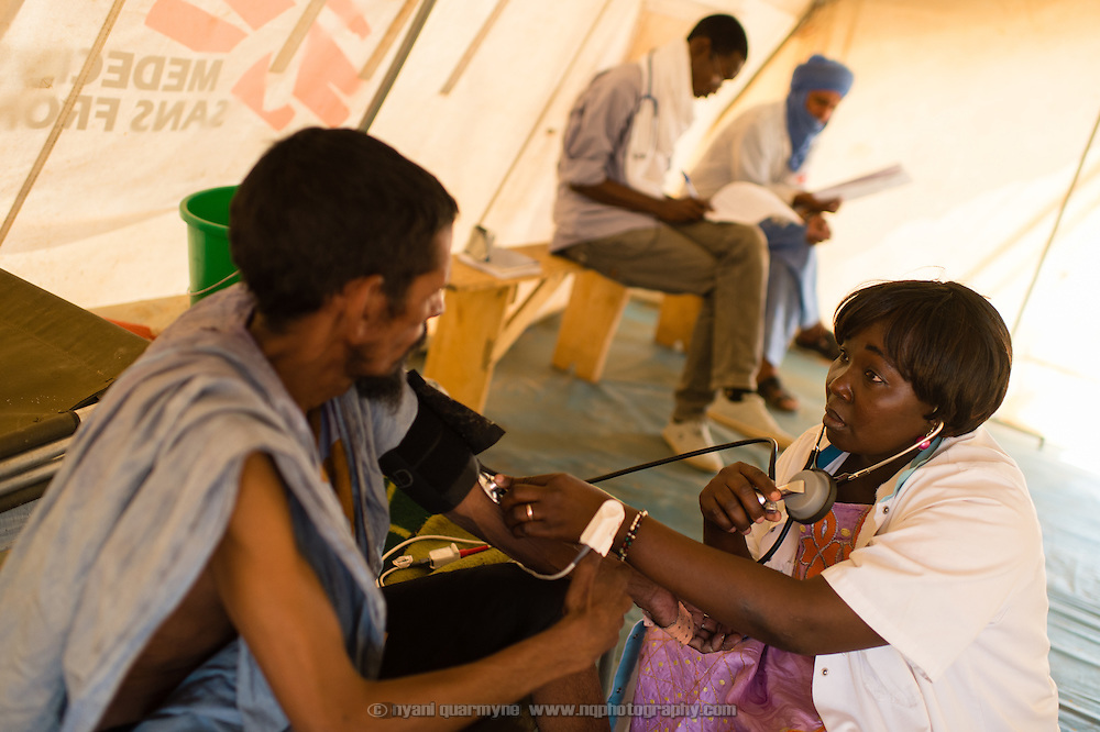 Nurse, Fatoumata Sangaré, with Alhassane Ould Mohamed in an isolation ward at a Médecins Sans Frontières (MSF) health centre at the Mbera camp for Malian refugees in Mauritania, on 5 March 2013. Alhassane is suspected of having tuberculosis, and is being treated in isolation while test results are awaited.
