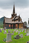 """Built in 1170, Lom Stave Church (stavkirke or stavkyrkje) was rebuilt into a cruciform, triple-nave church in 1663 and restored in 1933 and 1973. Visit this wooden Norman-style church in the town of Lom, in Gudbrandsdal traditional district, Oppland county, Norway. """"Staves"""" are upright logs that support the central room framework."""