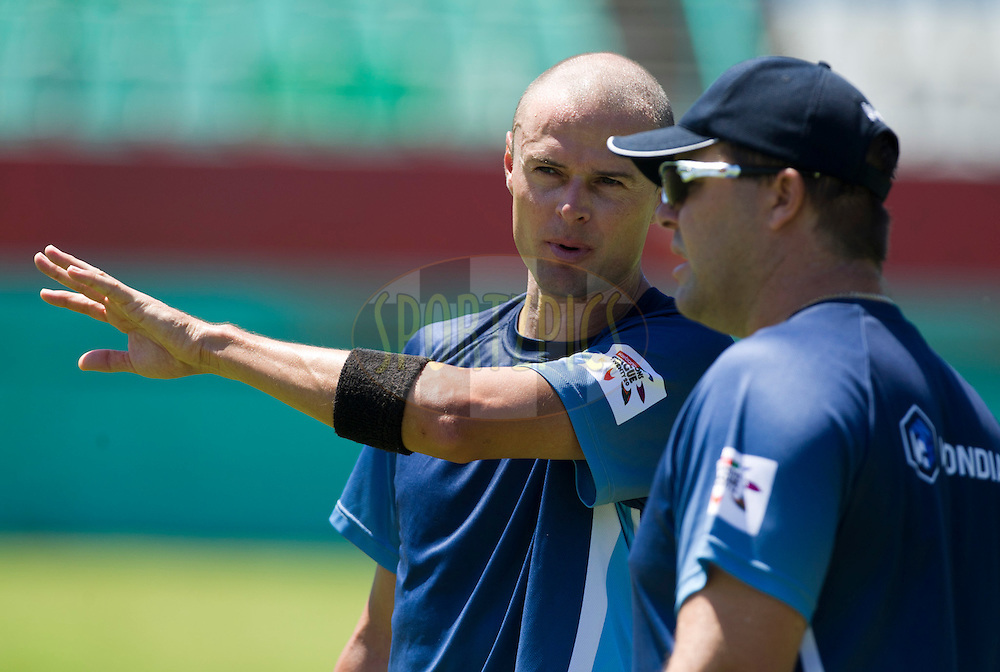 Chris Martin speaks to an unidentified coach during the Auckland Aces practice session held a Kingsmead Stadium in Durban on the 18th October 2012..Photo by Rogan Ward/SPORTZPICS/CLT20