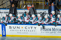 KELOWNA, CANADA - DECEMBER 30: Kelowna Rockets' coaching staff Kris Mallette, Jason Smith and Travis Crickard stand on the bench as the players celebrate a shoot out goal against the Victoria Royals on December 30, 2017 at Prospera Place in Kelowna, British Columbia, Canada.  (Photo by Marissa Baecker/Shoot the Breeze)  *** Local Caption ***