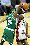 May 1, 2010; Cleveland, OH, USA; Cleveland Cavaliers forward LeBron James (23) tries to shoot over Boston Celtics center Rasheed Wallace (30) during the first quarter of game one in the eastern conference semifinals in the 2010 NBA playoffs at Quicken Loans Arena. Mandatory Credit: Dave Miller-US PRESSWIRE