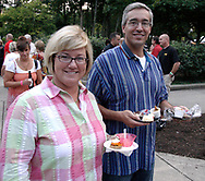 Tracie (left) and Fred Courville of Kettering hold some of the samples they picked up during the 21st annual The Taste in the Lincoln Park Commons area at the Fraze Pavilion, Thursday, September 3, 2009.  They shared the samples with their friends Tom & Bev Moore, visiting from Farmington, Michigan.
