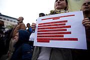 Frankfurt am Main | 28 Apr 2014<br /> <br /> Am Montag (28.04.2014) veranstalteten etwa 200 Menschen an der Hauptwache in Frankfurt am Main sogenannte Montagsdemos gegen Hartz IV und die Agenda 2010 und dann sp&auml;ter f&uuml;r den Frieden, gegen den Krieg etc., am zweiten Teil der Montagsdemo nahmen AfD-Aktivisten und die Neonazi-Aktivistin Sigrid Sch&uuml;&szlig;ler (NPD, RNF/Ring Nationaler Frauen) teil.<br /> Hier: Aktivistin mit einem Plakat mit der Aufschrift &quot;Wir leben in einer verkehrten Welt...&quot;.<br /> <br /> &copy;peter-juelich.com<br /> <br /> [No Model Release | No Property Release]