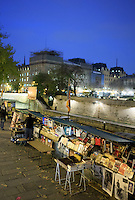 Stalls beside the Notre Dame Cathedral sell books in Paris, France, Europe.