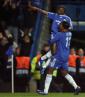 Photo: Paul Thomas.<br /> Chelsea v Levski Sofia. UEFA Champions League, Group A. 05/12/2006. <br /> <br /> Shaun Wright-Phillips (L) of Chelsea celebrates his goal with Didier Drogba.