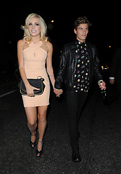 Singer Pixie Lott and Oliver Cheshire attends the Moschino Catwalk Show at at The Farmiloe Building, during London Fashion Week. UK. 15/09/2012<br />