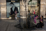 Visitors to the RHS Chelsea Flower Show organise their purchases in Sloane Square after the last day's plant sell-off.
