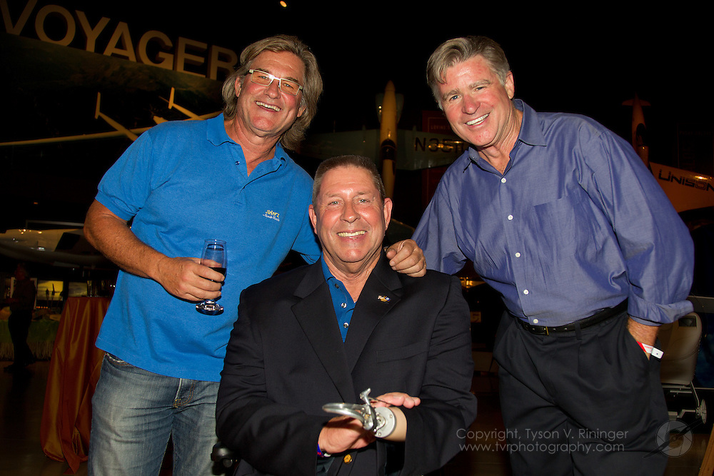 Vietnam Veteran and Triple Amputee, Jim Sursely talks and poses with actors and aviators Kurt Russell and Treat Williams at the annual EAA Young Eagles Dinner.