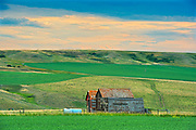 Old farmstead at dusk<br />Jct of Hwy 1 and 32<br />Saskatchewan<br />Canada