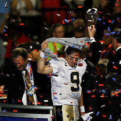 2010 February 07: New Orleans Saints quarterback Drew Brees (9) celebrates on stage following a 31-17 win by the New Orleans Saints over the Indianapolis Colts in Super Bowl XLIV at Sun Life Stadium in Miami, Florida.