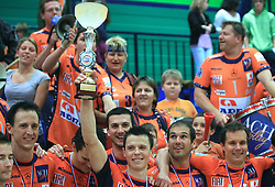 Matija Plesko and Players of ACH celebrate with a cup after last final volleyball match between OK ACH Volley and Salonit Anhovo, on April 21, 2009, in Arena SGS Radovljica, Slovenia. ACH Volley won the match 3:0 and became Slovenian Champion. (Photo by Vid Ponikvar / Sportida)