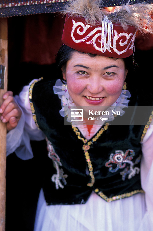 A young Kazakh woman by the door of the yurt, Kashgar, Xinjiang Province, Silk Road, China