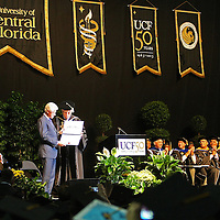 President Bill Clinton addresses graduates of UCF's College of Health and Public Affairs and the College of Medicine's Burnett School of Biomedical Sciences at the UCF Arena on Thursday, May 2, 2013 in Orlando, Florida. Clinton was also awarded an honorary degree by UCF President John Hitt that  recognizes his service as president and also his service as a humanitarian and international ambassador since he left office. This is his third visit to the UCF campus and he will be the second U.S. president to speak at a UCF graduation ceremony. President Richard M. Nixon addressed graduates in 1973.  (AP Photo/Alex Menendez)