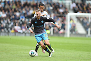 Sheffield Wednesday midfielder Aiden McGeady holds off Derby County midfielder Tom Ince during the Sky Bet Championship match between Derby County and Sheffield Wednesday at the iPro Stadium, Derby, England on 23 April 2016. Photo by Jon Hobley.