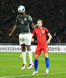 Germanys Antonio Rudiger heads the ball away under pressure from Harry Kane - Mandatory by-line: Matt McNulty/JMP - 26/03/2016 - FOOTBALL - Olympiastadion - Berlin, Germany - Germany v England - International Friendly