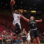 04 November 2016: The San Diego State Aztecs women's basketball team opens up the season with an exhibition against CSU San Marcos. San Diego State guard McKynzie Fort (15) goes in for a lay up after stealing the ball from San Marcos guard Dee Arementa (11) in the first quarter. The Aztecs beat the Cougars 74-53 at Viejas Arena Friday night.  www.sdsuaztecphotos.com