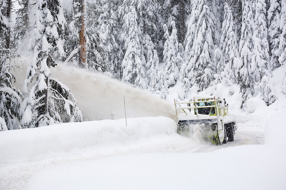 A large snowplow clears the roads near Mt. Baker in Washington State, USA.