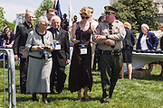 "(L-R)Nadia & Anatoly Kostiuchenko, Maura Kelley with Ventura County Senior Deputy Patrick Hawthorne attend the 34th Annual National Peace Officers Memorial Service to remember Kelly's late husband and the Kostiuchenko's son, Ventura County sheriff's deputy Yehven ""Eugene"" Kostiuchenko at the west lawn of the U.S. Capitol on May 15, 2015. Yehven, a Ukrainian hit by a drunk driver last October who came to the U.S. to investigate a money laundering case and met his future wife. Photo by Kris Connor"