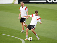 Thomas Muller of Germany (R) and Bastian Schweinsteiger of Germany (L) during the Germany training session at the Est&aacute;dio S&atilde;o Janu&aacute;rio, Rio de Janeiro, ahead of tomorrow's World Cup Final. <br /> Picture by Andrew Tobin/Focus Images Ltd +44 7710 761829<br /> 12/07/2014